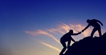 13242-men-helping-climb-hand-arm.1200w.tn